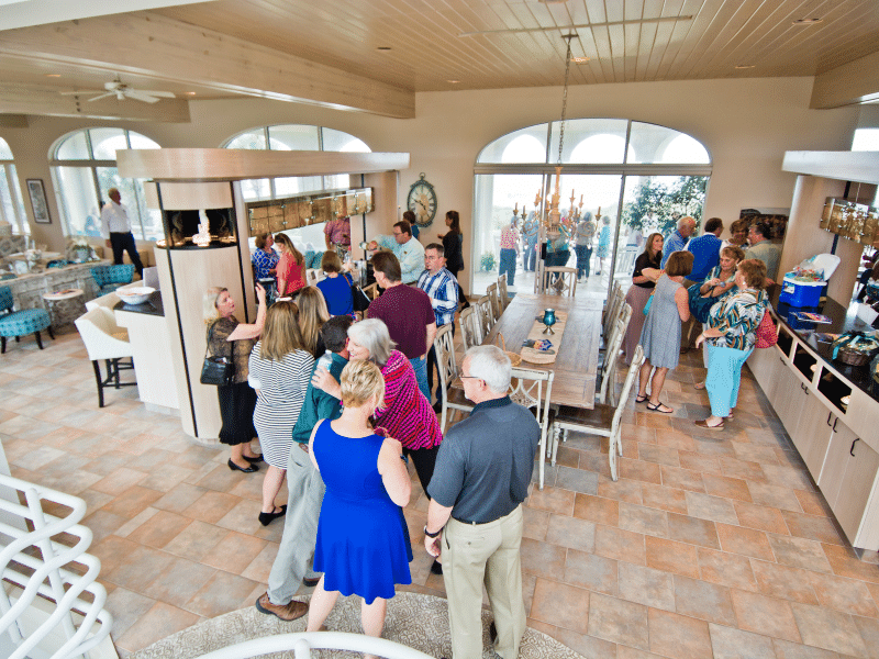 Guests chatting and mingling during an event at Chateau of the Isle in Indian Beach NC